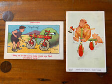 2 x Antique Signed Lawson Wood Cycling Humour Postcards Monkey Bike Prehistoric