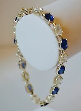 Cute 925 Sterling CZ CH signed SU. Clear CZ and Sapphire tennis bracelet