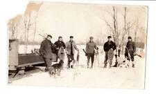 Vintage image Rabbit hunters guns hound dogs snow shoes sled winter scene #