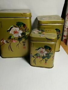 Set of 3 metal nesting boxes--gold with oriental bird and flower images-vintage