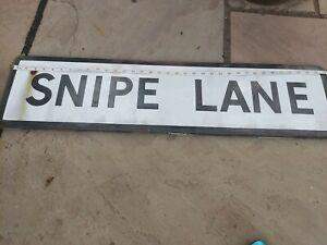 old tin road sign snipe lane