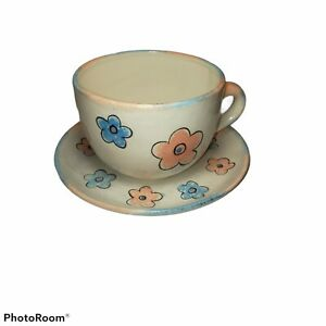 Vintage Tea cup and saucer hand painted blue and peach flowers.