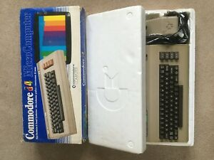 Commodore C64 computer + Vic 1541 Floppy Drive + Quickshot Joyball