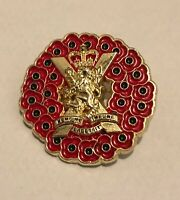 POPPY WREATH ROYAL REGIMENT OF SCOTLAND BADGE IN GOLD METAL