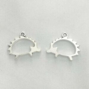 Tibetan silver hollow hedgehog charms pendants 21mm x 16mm C282