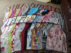 PVC waterproof  aprons adult and child's 5 sizes over 30 designs wipe clean