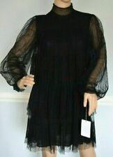 Vestiti da donna neri con fantasia pois