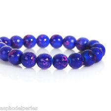 30 perles en verre bleu effet moucheté rose 8 mm