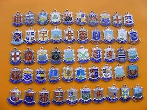 1b) VARIOUS VINTAGE STERLING SILVER CHARM CHARMS UK TRAVEL SHIELD