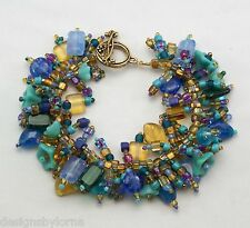 "Bracelet: ""Peacock"" Glass beads in rich colors! Fringe Magic"