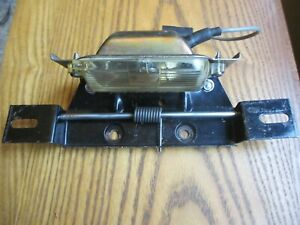 NOS 1962 1963 1964 BUICK LICENSE PLATE LIGHT AND LICENSE PLATE HOLDER ASSEMBLY