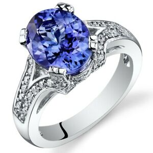 4.28 Carats Oval Shape Tanzanite Diamond Ring in 14Kt White Gold Size 7