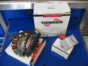 Genuine Tecumseh 7 amp alternator and under shroud regulator New In Box