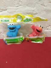 Lot of 2 Elmo And Cookie Monster Collectible Toys