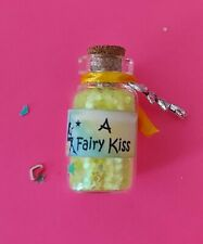 bottle of fairy kiss dust (yellow) with an organza bag