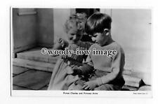 r2448 - Prince Charles & Princess Anne outside playing with a Toy - postcard