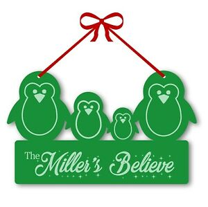 Our family believe penguin personalised Christmas door window decoration plaque