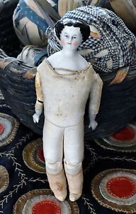 Antique High Brow China Head Doll with original Leather Body
