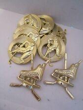 12 ice hockey trophy parts. skates, pucks & sticks. Gold tone plastic & metal
