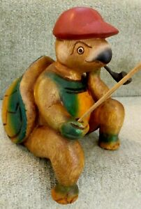Hand carved wood FISHING TURTLE caricature with cocked leg and pipe for shelf.