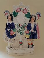 Staffordshire vintage Victorian antique figurine ornament of couple with a clock