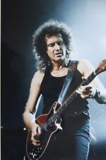 Photo of Brian May of Queen in concert mounted 12 x 8 inches by Mel Longhurst