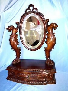 Antique carved Black Forest mirror and make-up cabinet