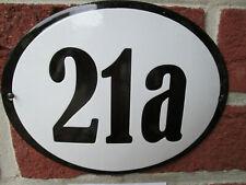 Hausnummer Oval Emaille schwarze Zahl Nr. 21a  weißer Hintergrund 19 cm x 15 cm