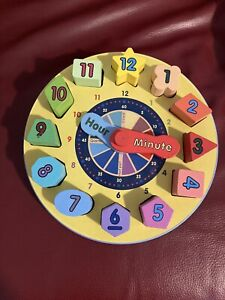 Melissa and Doug Shape Sorting Clock puzzle - like new