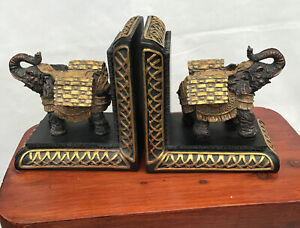 UNUSUAL RESIN ELEPHANTS BOOKENDS WITH A GOLD AND BLACK FINISH