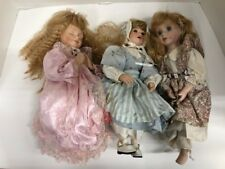 Lot of 3 - Porcelain Dolls - with Clothes