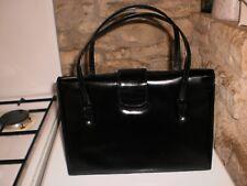 Trés beau sac à main vintage cuir noir années 60