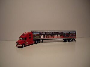 SPECCAST 1/64 IH FARMALL VOLVO 770 WITH SLEEPER AND LOGOED 53' DRY VAN DCP TIE