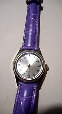 Quartz ladies battery operated wrist watchg with lavender faux crock band