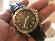 SWISS ARMY QUARTZ WATCH WITH DATE FUNCTION. ROTATING BEZEL -- NEW BATTERY