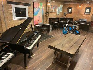 Small Shiny Black Baby Grand Piano at Sherwood Phoenix Spring Piano Sale