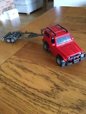 Red Toy Landrover With Trailer