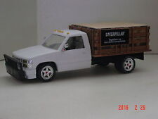 1998 Chevy stake truck with Catipilar Stock on board