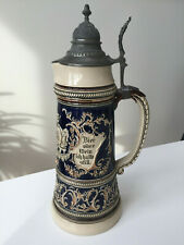 Old German beer stein in ceramic with a metal lid