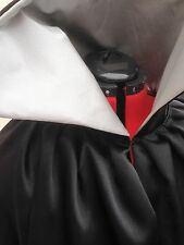 long black satin cloak.with silver lining and large collar. rocky horror style