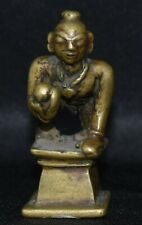 Crawling Krishna with butter ball in his hand  and 2 inches tall 1.5 inches deep