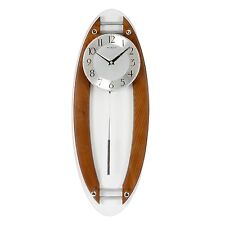 MODERN OVAL WOOD / SILVER & GLASS WALL CLOCK WITH PENDULUM. NEW AND BOXED.