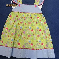 Petit Ami 12 months  dress  In lime, pinks,purples, and blues new w/tags