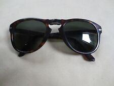 Persol brown tortoiseshell frame folding sunglasses.
