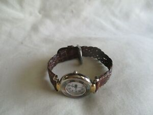 Fossil Analog Wristwatch with a Buckle Band and Water Resistance