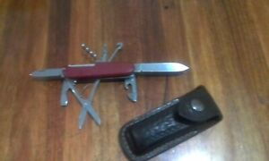 Swiss army knife with leather belt pouch.