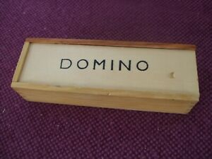 Boxed set of dominoes with instruction sheet. Complete