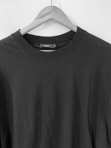 BASSIKE cropped shaped Tshirt in black.  Excellent condition. L