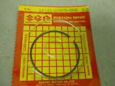 Suzuki NOS RM80, 1986-1990, RING, .5mm over size  P/N 12141-02B50-050 S64