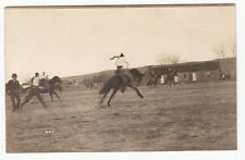 [60031] OLD REAL PHOTO POSTCARD COWBOY RIDING A STEER